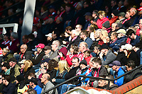 Lincoln City fans watch their team in action<br /> <br /> Photographer Andrew Vaughan/CameraSport<br /> <br /> The EFL Sky Bet League Two - Lincoln City v Cheltenham Town - Saturday 13th April 2019 - Sincil Bank - Lincoln<br /> <br /> World Copyright &copy; 2019 CameraSport. All rights reserved. 43 Linden Ave. Countesthorpe. Leicester. England. LE8 5PG - Tel: +44 (0) 116 277 4147 - admin@camerasport.com - www.camerasport.com