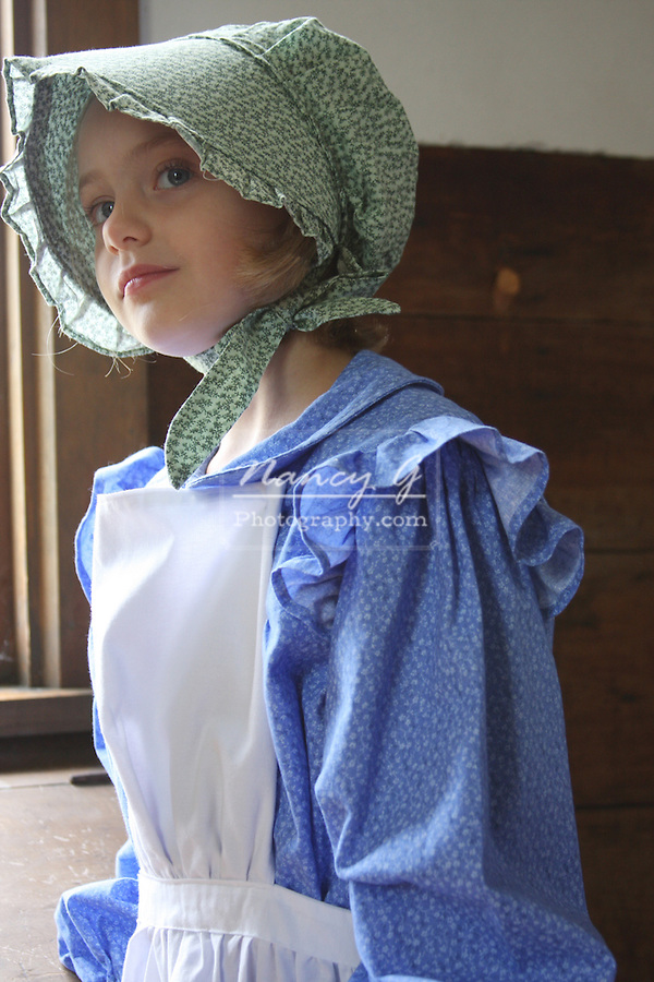 A young girl in a historic schoolroom