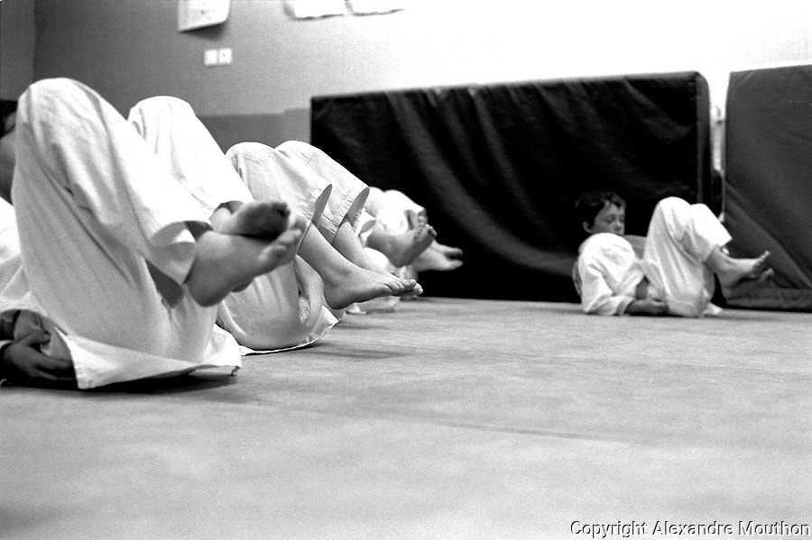Judo lesson, kids are learning how to accept falling.