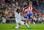 Antoine Griezmann of Club Atletico de Madrid battles for the ball with Bakary Kone of Malaga CF during their La Liga match between Club Atletico de Madrid and Malaga CF at the Estadio Vicente Calderón on 29 October 2016 in Madrid, Spain. Photo by Diego Gonzalez Souto / Power Sport Images