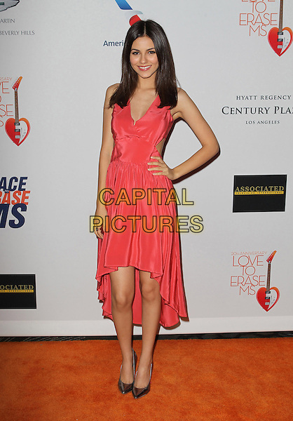 Victoria Justice.20th Annual Race To Erase MS Gala held at the Hyatt Regency Century Plaza Hotel, Century City, California, USA, 3rd May 2013..full length cut out dress hand on hip red smiling silver shoes .CAP/ADM/KB.©Kevan Brooks/AdMedia/Capital Pictures