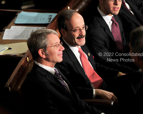 United States Representative Elliot Engel (Democrat of New York), on the floor of the U.S. House as he waits to be sworn-in for another term in the U.S. House of Representatives. U.S. Representative Barbara Lee (Democrat of California), is seated at left.  The person at left is unidentified. .Credit: Ron Sachs / CNP.(RESTRICTION: NO New York or New Jersey Newspapers or newspapers within a 75 mile radius of New York City)