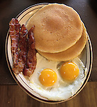The South Main Diner in Caseyville features a wide selection of entrees for breakfast, lunch and supper on its menu. Hot cakes with bacon and eggs.