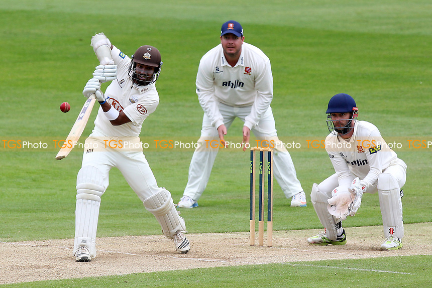 Arun Harinath of Surrey hits out as James Foster (R) and Jesse Ryder look on - Essex CCC vs Surrey CCC - LV County Championship Division Two Cricket at the Essex County Ground, Chelmsford, Essex - 26/05/14 - MANDATORY CREDIT: Gavin Ellis/TGSPHOTO - Self billing applies where appropriate - 0845 094 6026 - contact@tgsphoto.co.uk - NO UNPAID USE