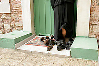 Taking shoes off before entering a mosque, Istanbul, Turkey