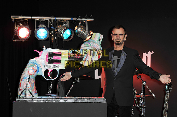 Ringo Starr.Unveiling of the 'Knotted Gun' statue for the Non Violence Foundation, Gibson Guitar Studio, London, England. .8th December 2011.half length black suit sunglasses shades beard facial hair hands arms.CAP/MAR.© Martin Harris/Capital Pictures.