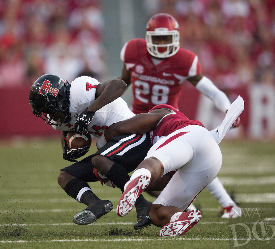 Arkansas Democrat-Gazette/MELISSA SUE GERRITS - 09/19/15 - Arkansas Razorbacks' Dre Greenlaw takes down Texas Tech's Jakeem Grant in the second quarter September 19, 2015 at Donald W. Reynolds Razorbacks Stadium in Fayetteville.