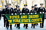 Members of the Pipes and Drums of New York State Courts march near Central Park in Manhattan during the annual St. Patrick's Day Parade in New York City on March 17, 2011.