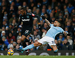 Diafra Sakho of West Ham United tackled by Nicolas Otamendi of Manchester City during the premier league match at the Etihad Stadium, Manchester. Picture date 3rd December 2017. Picture credit should read: Andrew Yates/Sportimage