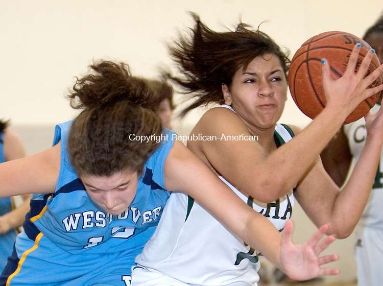 MIDDLEBURY, CT. 14 January 2012-011412SV13-#23 Natalie Fitzgerald of Chase and #15 Eve Brigham of Westover battle for the loose ball during basketball action in Middlebury Saturday..Steven Valenti Republican-American