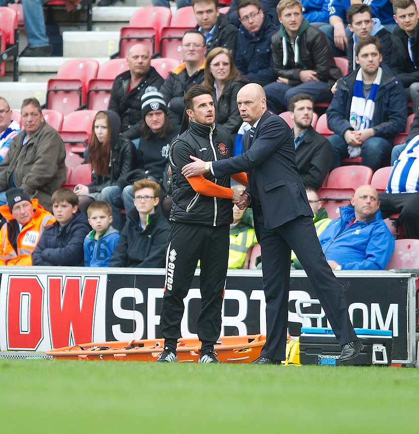 Blackpool's Manager Barry Ferguson is congratulated by Wigan Athletic's Manager Uwe Rosler after the final whistle<br /> <br /> Photo by Stephen White/CameraSport<br /> <br /> Football - The Football League Sky Bet Championship - Wigan Athletic v Blackpool - Saturday 26th April 2014 - DW stadium - Wigan<br /> <br /> &copy; CameraSport - 43 Linden Ave. Countesthorpe. Leicester. England. LE8 5PG - Tel: +44 (0) 116 277 4147 - admin@camerasport.com - www.camerasport.com