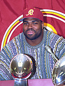 Washington Redskins defensive tackle Sean Gilbert (90) makes remarks during a press conference announcing the team traded their 1996 first round draft choice (the sixth overall) to the St. Louis Rams for his services at Redskins Park in Ashburn, Virginia on April 9, 1996.<br /> Credit: Arnie Sachs / CNP
