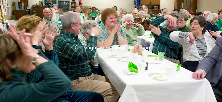 OXFORD, CT- 13 MARCH 07- 031207JT04- <br /> Sharon Tantimonaco, center, claps along to a song with friends at the St. Patrick's Day Party at the Oxford Senior Center. From left to right are Marie Claire Baril, Sandra Benham, John Shail, Mary Anne Shail, Tantimonaco, and Walt and Pat Gadsky.<br /> Josalee Thrift Republican-American