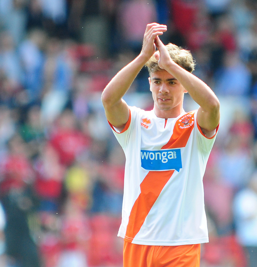 Blackpool's Dominic Telford applauds the fans at the end of the game<br /> <br /> Photographer Chris Vaughan/CameraSport<br /> <br /> Football - The Football League Sky Bet Championship - Nottingham Forest v Blackpool - Saturday 9th August 2014 - The City Ground - Nottingham<br /> <br /> &copy; CameraSport - 43 Linden Ave. Countesthorpe. Leicester. England. LE8 5PG - Tel: +44 (0) 116 277 4147 - admin@camerasport.com - www.camerasport.com