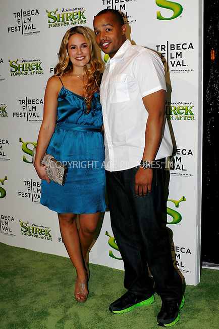 WWW.ACEPIXS.COM . . . . .  ....April 21 2010, New York City....Actor Donald Faison (R) and CaCee Cobb arriving at the premiere of 'Shrek Forever After' as part of the Tribeca Film Festival at the Ziegfeld Theatre on April 21 2010 in New York City....Please byline: NANCY RIVERA- ACEPIXS.COM.... *** ***..Ace Pictures, Inc:  ..Tel: 646 769 0430..e-mail: info@acepixs.com..web: http://www.acepixs.com