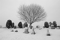 Snow falls on a country cemetery in Ohio.<br />