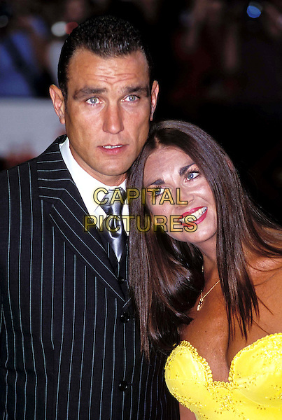 VINNIE JONES & WIFE TANYA.Ref:9945.football, pinstripe suit, yellow, headshot, portrait, married, loving.www.capitalpictures.com.sales@capitalpictures.com.©Capital Pictures