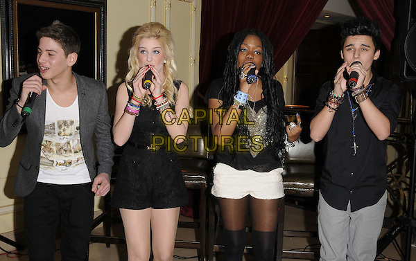 EverYoung ( L-R, Eyal Booker, Hollie McKinlay, Jack Morlen & Cherelle Williams ).The 'Ask Alfred' new children's concierge service celebrity launch party, Millennium Mayfair hotel, Grosvenor Square, London, England..February 2nd, 2012.half length black shorts jacket shirt singing necklace white concert live gig performance performing music band group  jeans denim.CAP/CAN.©Can Nguyen/Capital Pictures.