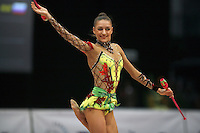 Evgenia Kanaeva of Russia expresses with clubs at 2008 Portimao World Cup of Rhythmic Gymnastics on April 20, 2008.  Photo by Tom Theobald.