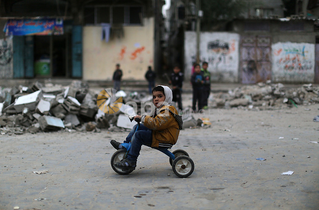 A Palestinian boy poses for a photograph in Shati refugee camp in Gaza city on Jan. 07, 2016. Photo by Ezz al-Zanoun
