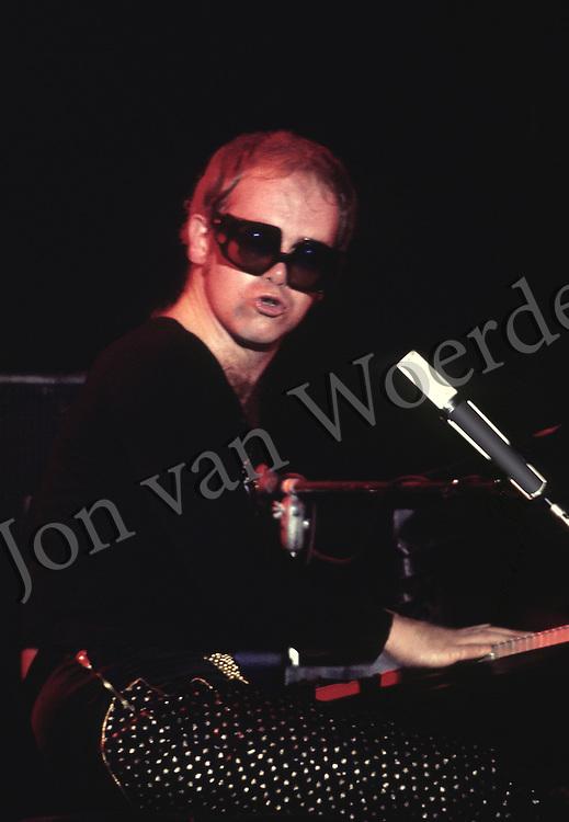 Elton John performs in concert.