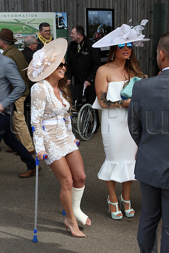 08.04.2016. Aintree, Liverpool, England. Crabbies Grand National Festival Day 2. Lady undeterred by a plaster cast arrives at the track.