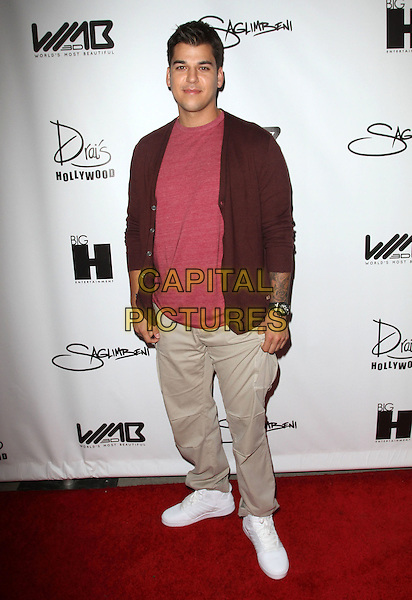 Rob Kardashian.The World's Most Beautiful Magazine Launch Event held at Drai's in Hollywood, California, USA..August 10th, 2011.full length beige khaki trousers pink red top cardigan brown.CAP/ADM/KB.©Kevan Brooks/AdMedia/Capital Pictures.