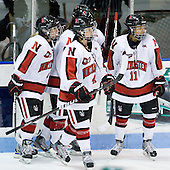 Casey Pickett (Northeastern - 14), Maggie DiMasi (Northeastern - 4), Rachel Llanes (Northeastern - 11) - The Northeastern University Huskies defeated the visiting Clarkson University Golden Knights 5-2 on Thursday, January 5, 2012, at Matthews Arena in Boston, Massachusetts.