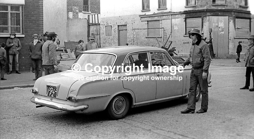 Masked members of the loyalist para-military Ulster Defence Association operating a vehicle checkpoint in the predominently Protestant Woodvale district of Belfast, N Ireland, UK, on 14th May 1972. 197205140563a<br />