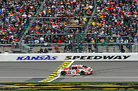 Kevin Harvick (#29) takes the checkered flag.