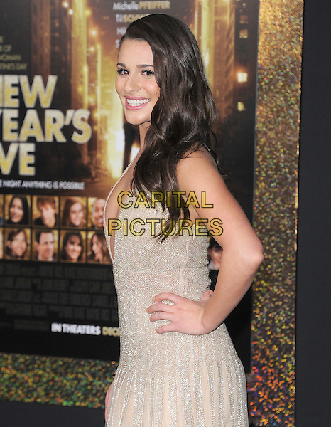 "Lea Michele.The World Premiere of ""New Year's Eve' held at The Grauman's Chinese Theatre in Hollywood, California, USA..December 5th, 2011.half length dress hand on hip side beige gold sparkly halterneck plunging neckline cleavage .CAP/RKE/DVS.©DVS/RockinExposures/Capital Pictures."
