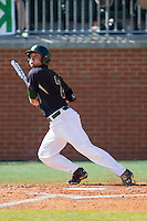 Brad Elwood (2) of the Charlotte 49ers follows through on his swing against the Canisius Golden Griffins at Hayes Stadium on February 23, 2014 in Charlotte, North Carolina.  The Golden Griffins defeated the 49ers 10-1.  (Brian Westerholt/Four Seam Images)