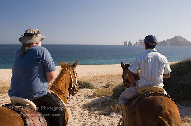 Horseback riding on El Medano beach (playa), Cabo San Lucas, Baja California, Mexico