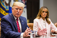 U.S. President Donald Trump speaks during an opioid round table at the White House in Washington, DC, USA, 12 June 2019. At right is U.S. First Lady Melania Trump.<br /> Credit: Zach Gibson / Pool via CNP/AdMedia