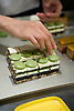 AOKI Patisserie.  Chef preparing mini Zen pastries (layers of green tea, sesame cream and chocolate).