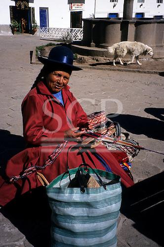 Cusco, Peru. Quechua lady making and selling woven belts in the San Blas region of Cusco.