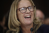 Professor Christine Blasey Ford, who has accused U.S. Supreme Court nominee Brett Kavanaugh of a sexual assault in 1982, reacts while testifying before a Senate Judiciary Committee confirmation hearing for Kavanaugh on Capitol Hill in Washington, U.S., September 27, 2018. REUTERS/Jim Bourg