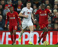 2nd January 2020; Anfield, Liverpool, Merseyside, England; English Premier League Football, Liverpool versus Sheffield United; Sadio Mane of Liverpool runs with the ball  - Strictly Editorial Use Only. No use with unauthorized audio, video, data, fixture lists, club/league logos or 'live' services. Online in-match use limited to 120 images, no video emulation. No use in betting, games or single club/league/player publications