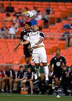 Christian Castillo (12) of D.C. United goes up for a header against Robbie Russell (3) of Real Salt Lake during a U.S. Open Cup tournament game at RFK Stadium in Washington, DC.  D.C. United defeated Real Salt Lake, 2-1, in overtime.