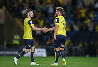 Dan Crowley (left) of Oxford United congratulates Alex MacDonald of Oxford United on his goal during the The Checkatrade Trophy match between Oxford United and Exeter City at the Kassam Stadium, Oxford, England on 30 August 2016. Photo by Andy Rowland / PRiME Media Images.