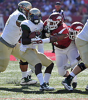 NWA Media/Michael Woods --10/25/2014-- w @NWAMICHAELW...University of Arkansas defender Darius Philon makes the tackle on UAB  running back D.J. Vinson in the 2nd quarter of Saturday's game at Razorback Stadium in Fayetteville.