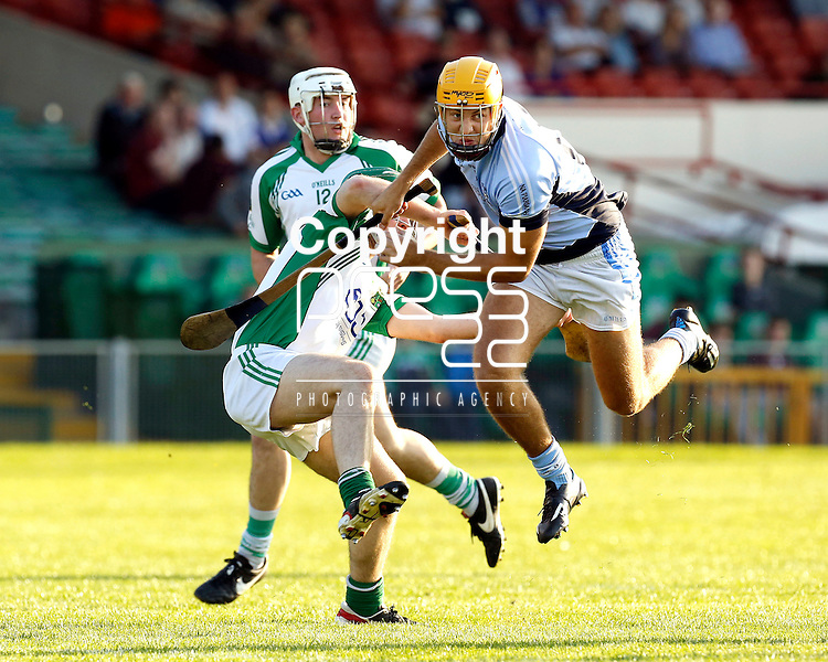 13/09/2014<br /> James O'Brien of Na Piarsaigh collides with Brian Quinn of Ballybrown in the Round 5 of the Limerick Senior Hurling Championship match which took place at the Gaelic Grounds, Limerick.<br /> Pic: Don Moloney/Press 22