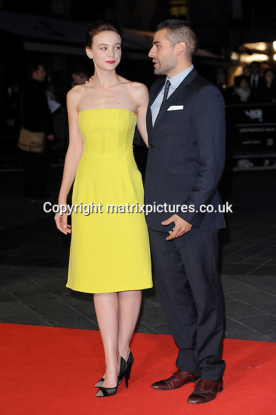 NON EXCLUSIVE PICTURE: PAUL TREADWAY / MATRIXPICTURES.CO.UK<br /> PLEASE CREDIT ALL USES<br /> <br /> WORLD RIGHTS<br /> <br /> English actress Carey Mulligan and Guatemalan-American actor, Oscar Isaac attend the screening of Inside Llewyn Davis Centrepiece Gala Supported By The Mayor Of London, during the 57th BFI London Film Festival at the Odeon Leicester Square cinema, in London.<br /> <br /> OCTOBER 15th 2013<br /> <br /> REF: PTY 136765