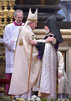 Pope Francis hugs the Head of Armenia's Orthodox Church Karekin II, in the Sunday's Mass in the Armenian Catholic rite at Peter's Basilica  at the Vatican, on April 12, 2015.