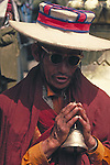 Lhasa, a Tibetan man with a bell