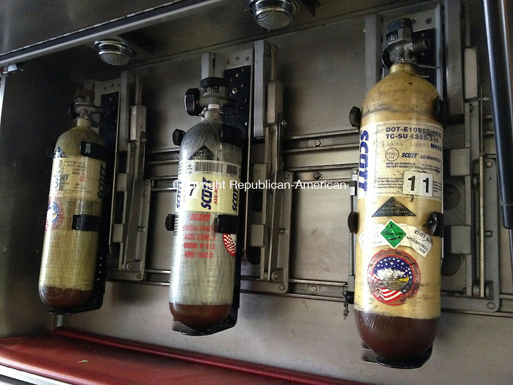 MIDDLEBURY, CT - Air bottles are stored in a compartment of a town fire truck. Each contains 4,500 pounds of air, enough for 30 minutes. Bill Bittar Republican-American