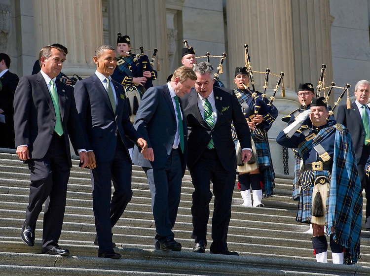 WASHINGTON, DC - March 17: House Speaker John A. Boehner, R-Ohio, President Barack Obama, Irish Taoiseach (Prime Minister) Enda Kenny, and Rep. Peter T. King, R-N.Y., walk down the House steps of the U.S. Capitol past the U.S. Air Force Pipe Band after the St. Patrick's Day luncheon inside. (Photo by Scott J. Ferrell/Congressional Quarterly)