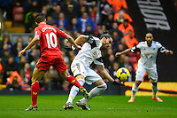 Sunday, 23 February 2014<br /> Pictured: Swansea City's Chico battlers with Liverpool's Philippe Coutinho for the ball<br /> Re: Barclay's Premier League, Liverpool FC v Swansea City FC v at Anfield Stadium, Liverpool Merseyside, UK.