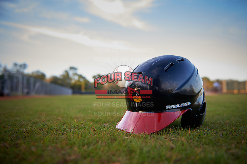 Illinois State Redbirds batting helmet sits in the grass after a game against the Indiana Hoosiers on March 4, 2016 at North Charlotte Regional Park in Port Charlotte, Florida.  Indiana defeated Illinois State 14-1.  (Mike Janes/Four Seam Images)