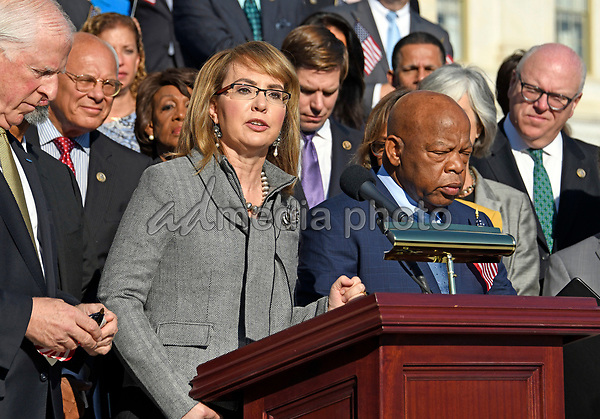 Former United States Representative Gabrielle Giffords (Democrat of Arizona) makes remarks as US House Democrats appear on the East Steps of the US Capitol to make a statement against gun violence in the wake of the Las Vegas Massacre in Washington, DC on Wednesday, October 4, 2017. Photo Credit: Ron Sachs/CNP/AdMedia